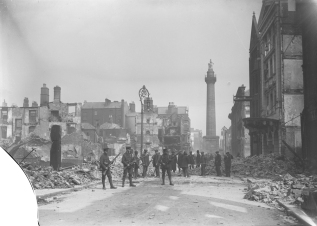 The ruins of Henry Street, workmen clearing rubble with armed soldiers on duty. Image: National Library of Ireland